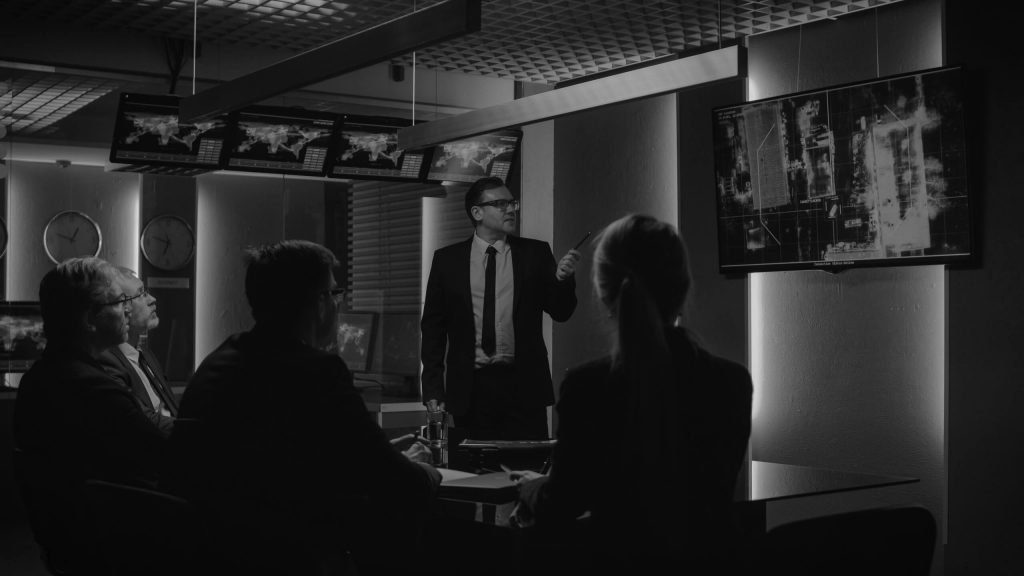Group of people in a counter terrorism situation room