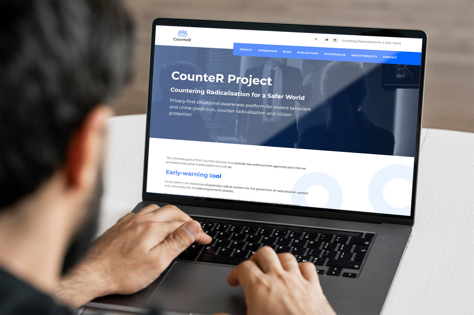 Man typing on a laptop with the Counter Project website open on the screen
